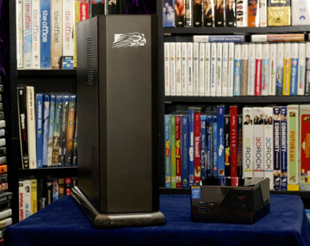 """The Brix next to the Falcon Northwest Tiki, a small form-factor gaming PC. """"Small"""" is obviously a relative term."""