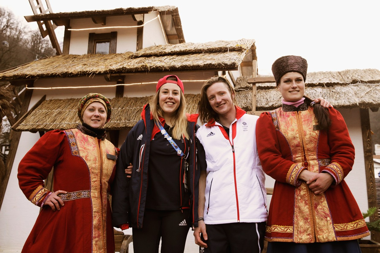 Katie Summerhayes and James 'Woodsy' Woods of Great Britain pose for a picture at the base of the Olympia Gondola on February 5, 2014 in Sochi, Russia.