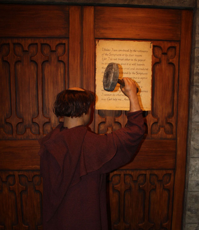 Martin Luther nails the Ninety-Five Theses to the door of the Wittenburg Church in an exhibit at the Creation Museum.