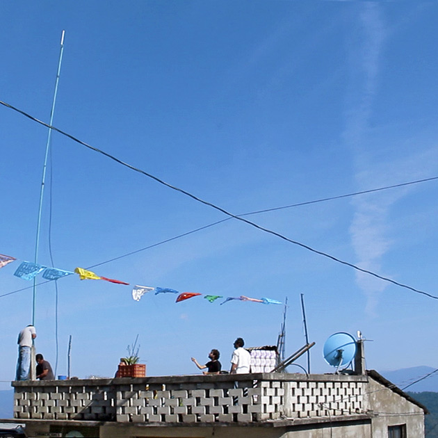 "A Range Networks system's antenna is raised on a roof in Oaxaca, Mexico as part of a partnership with <a href=""http://rhizomatica.org/"">Rhizomatica</a>, a nonprofit organization, to create a private cell network for 2,500 residents."