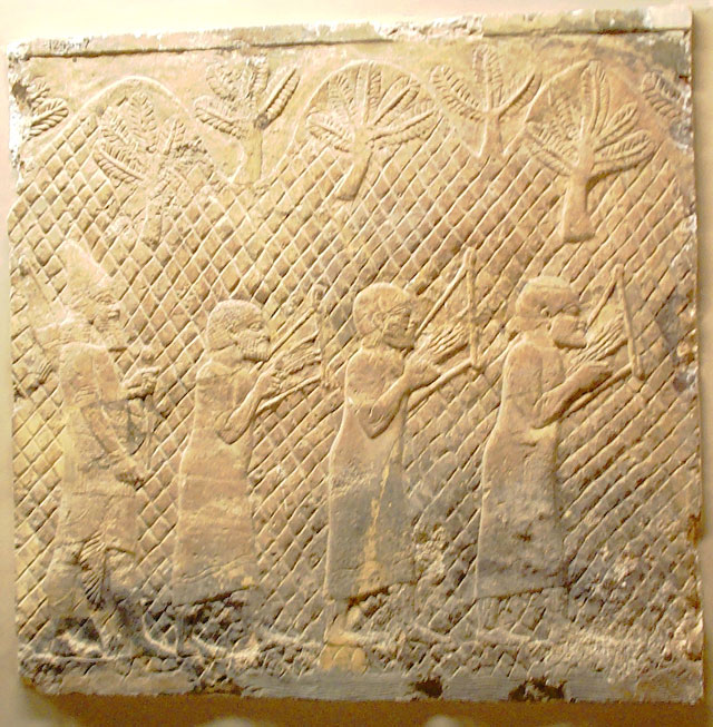 An Assyrian wall carving of prisoners being forced to play lyres. From the British Museum, dated between 790-592 BCE.
