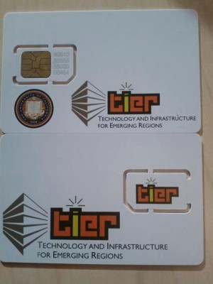 Two of the SIM cards produced by TIER for the Desa village network.