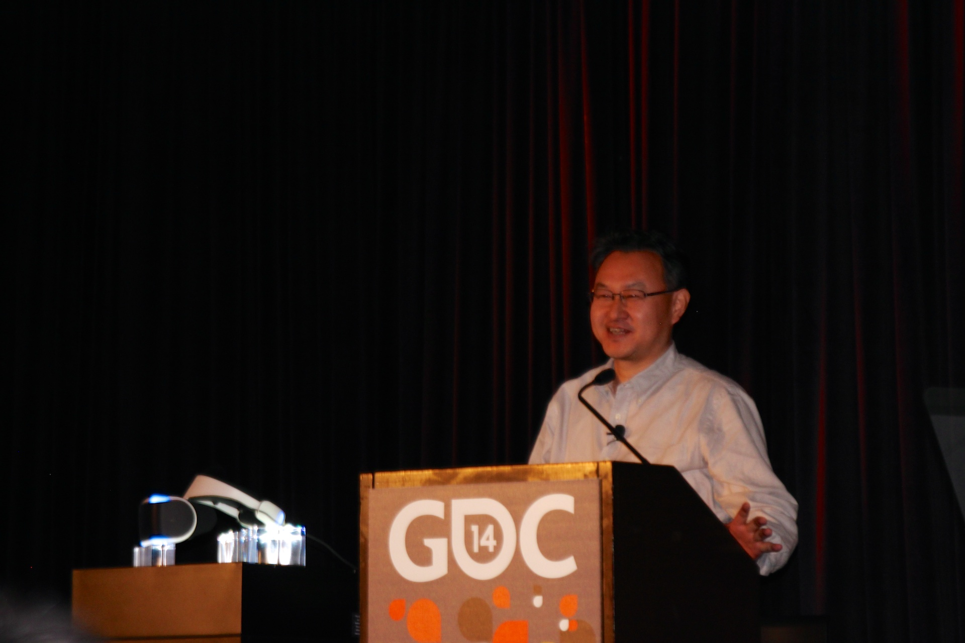 Yoshida speaks next to the just-unveiled Project Morpheus developer prototype.