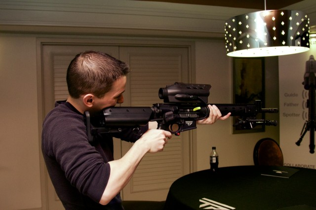 Ars Android expert Ron Amadeo hefts a TrackingPoint AR-15 prototype at the 2014 CES back in January.