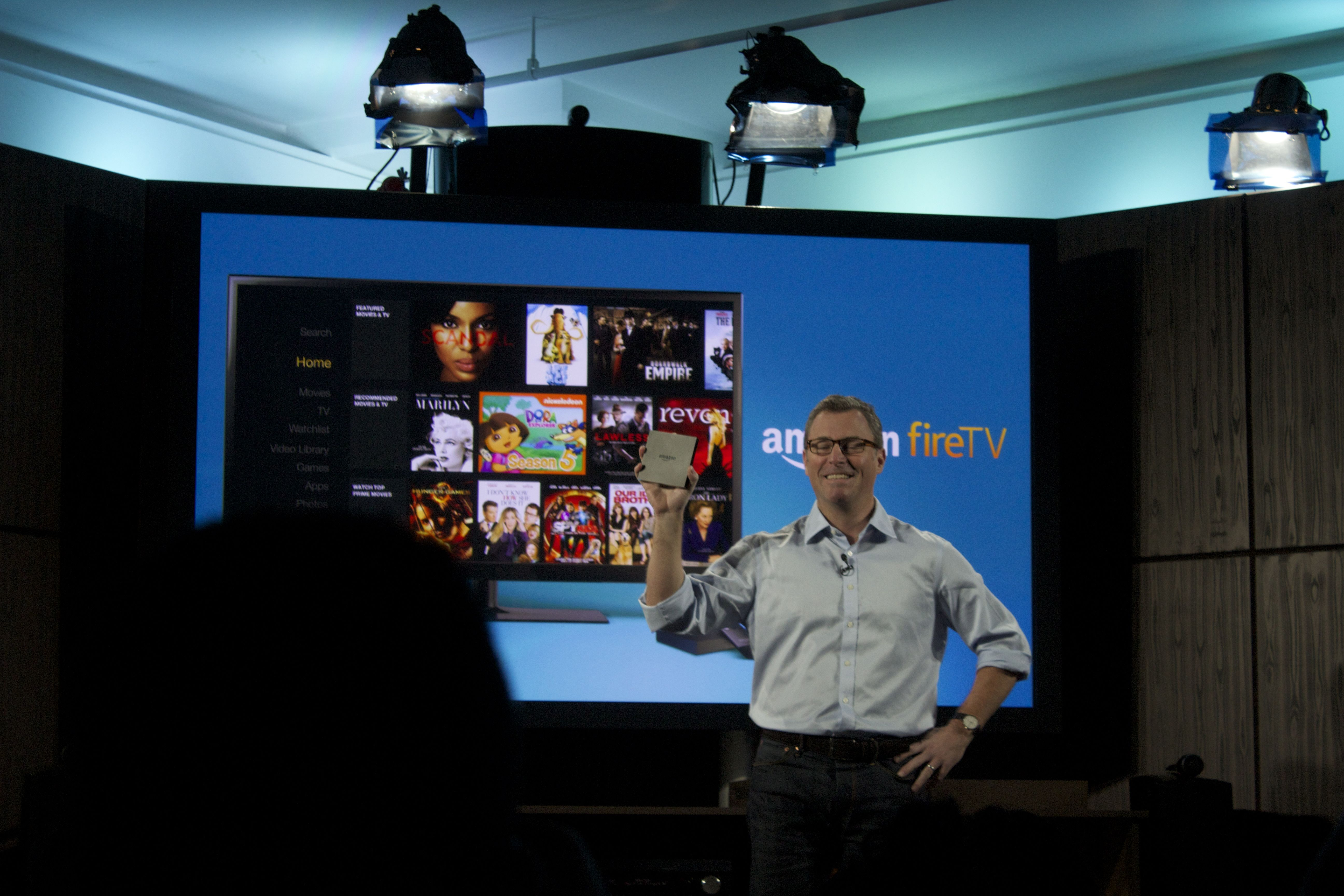 A demonstration of the Fire TV's physical size.