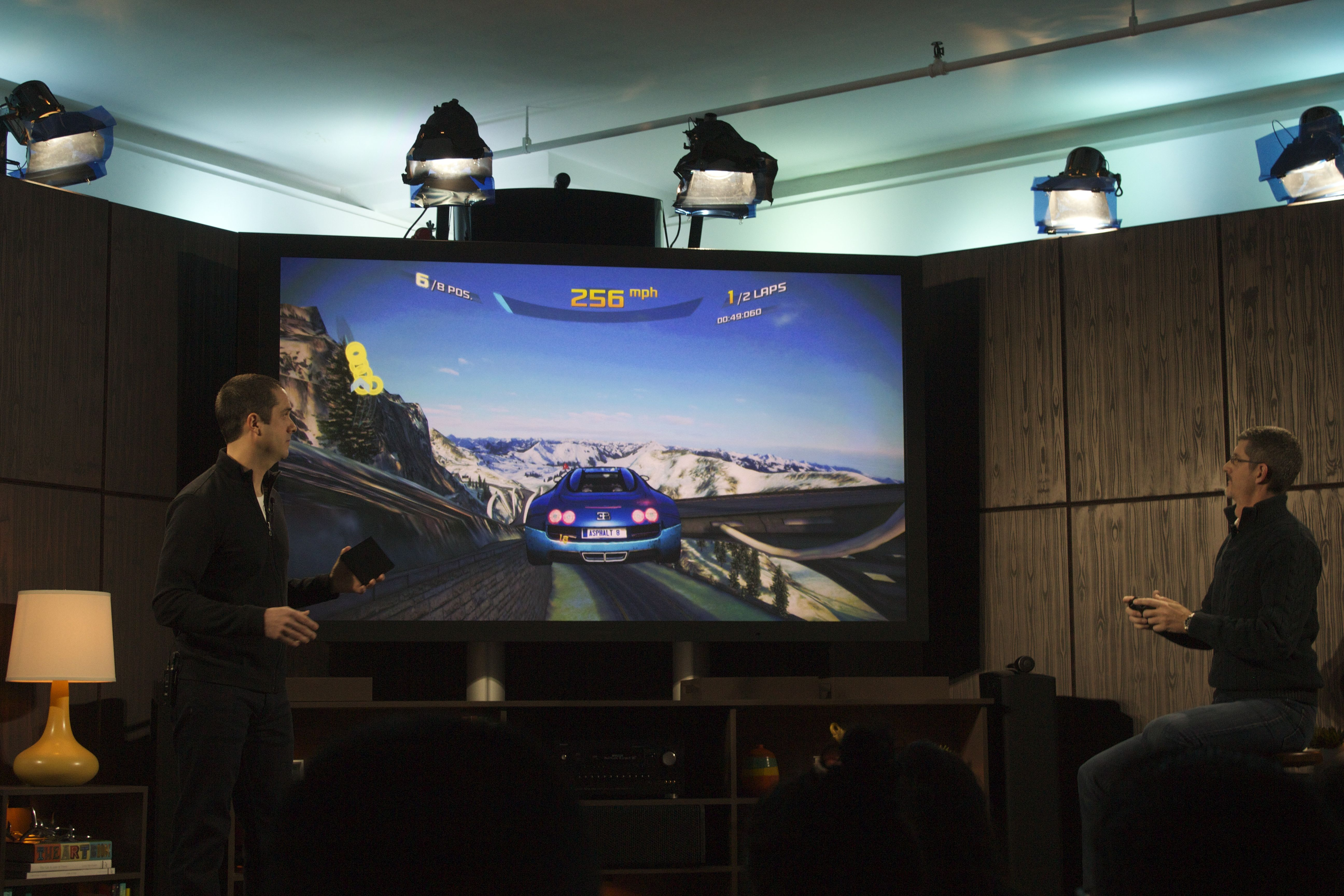 Two execs play a game with the Fire TV.