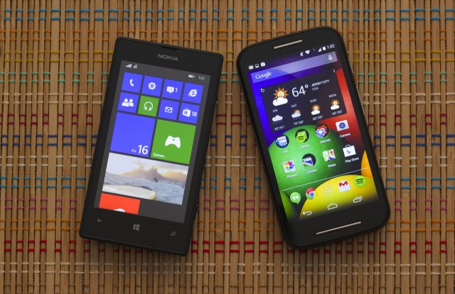The Moto E (right) next to the Lumia 520, Microsoft's current budget Windows Phone offering.