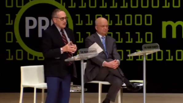 Dershowitz debates as his partner, Hayden, looks on.