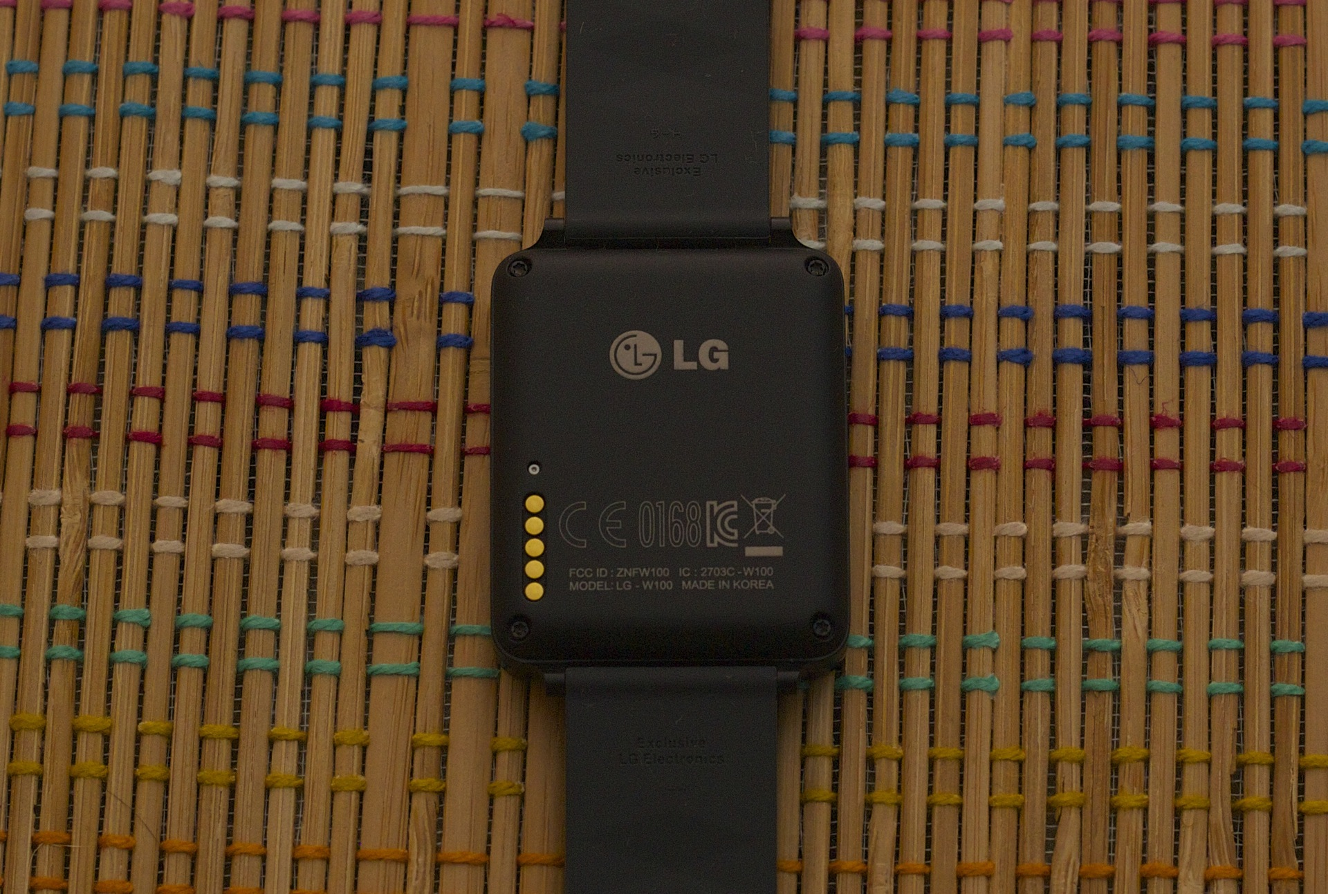 The G Watch just has pogo pins. Its completely flat back is less comfortable against one's wrist.