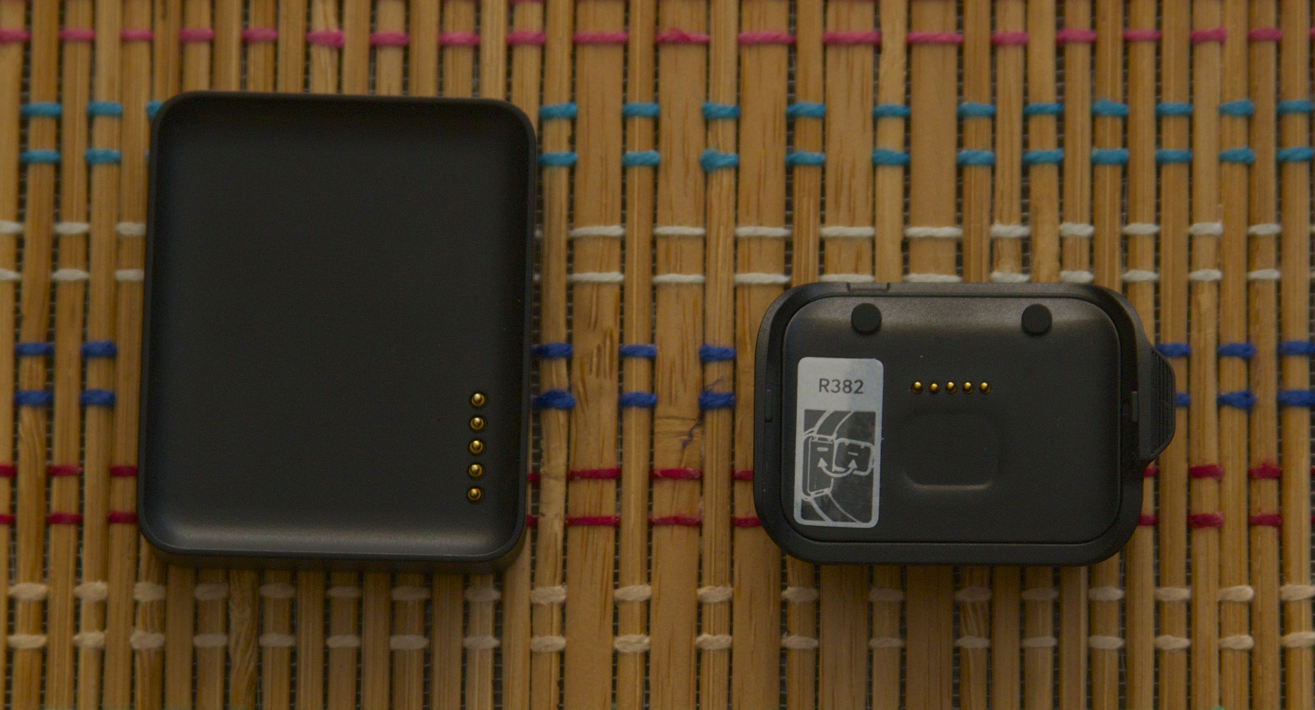 The G Watch charging cradle (left) and the Gear Live's smaller cradle (right).