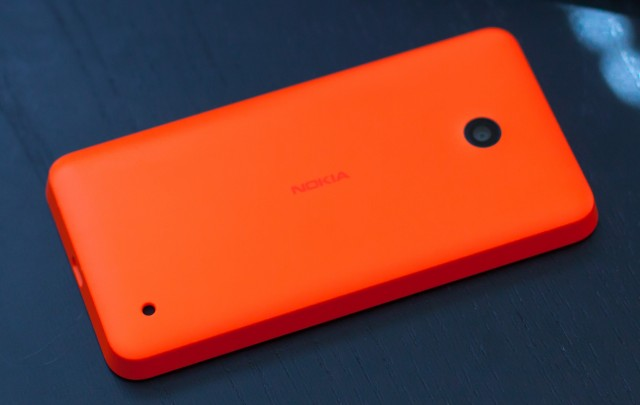 The picture can't actually capture the phone's full orangeness; its safety orange color is outside both sRGB and Adobe RGB gamuts.