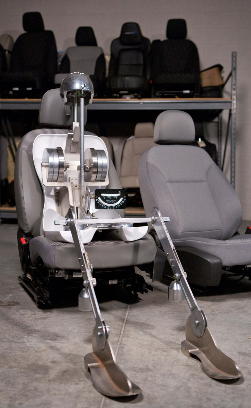 No, that's not the Terminator trying out a new car seat—it's GM's seating mannequin called Oscar.