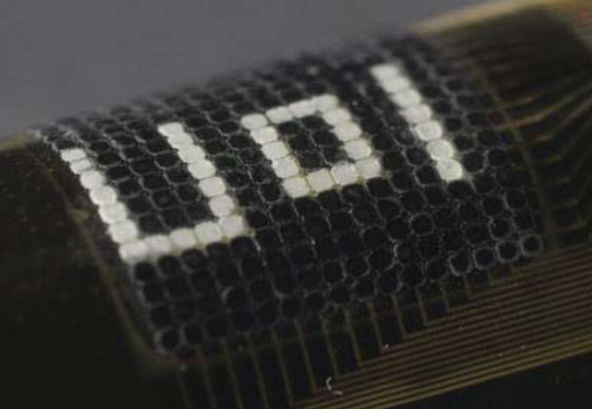 The authors, many of whom are at the University of Illinois, show off the device's ability with their school's abbreviation.