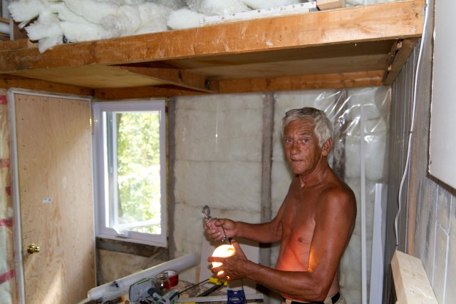 My dad with one of his epic tans. I think he was planning on upholstering a couch with a graft from his arms some day. He also showed me how to build that door from scratch because it wasn't a standard size.<br />
