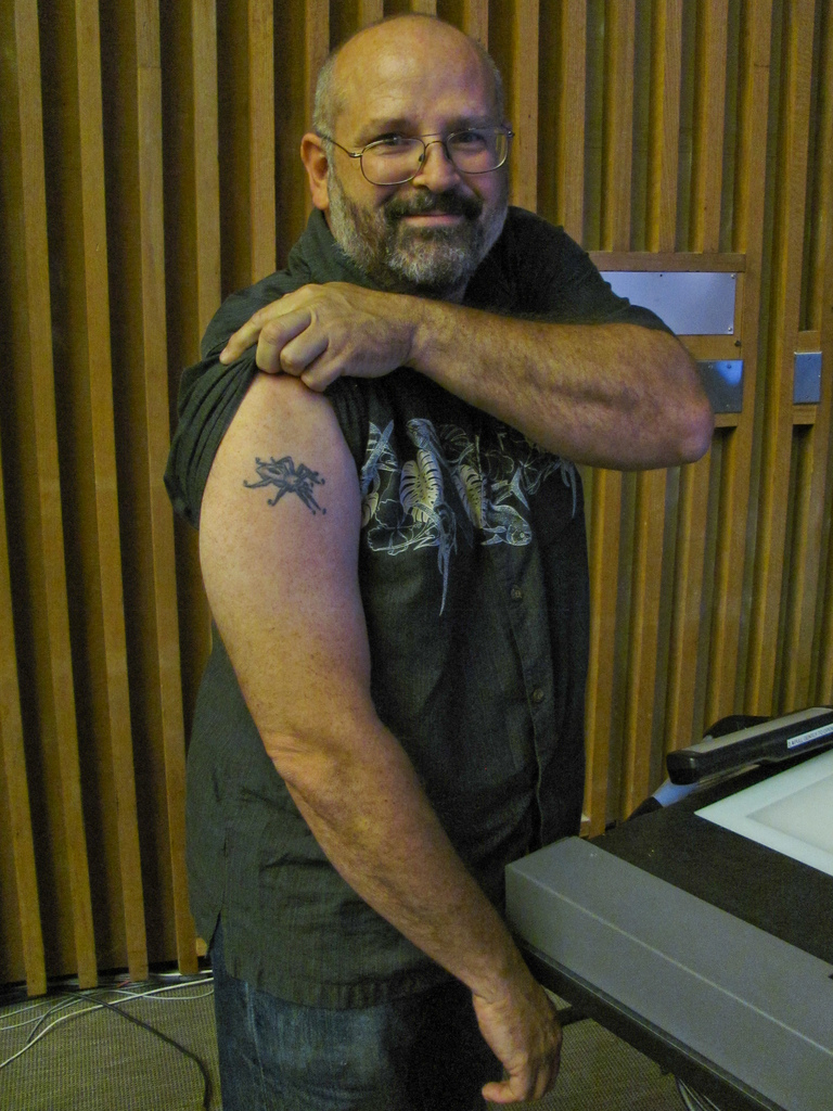 "Lycos founder Michael Mauldin shows off his spider tattoo, featuring the seven numbers of his 1997 patent for ""skimming"" digital audio and video files. Mauldin's patent was not one of the patents used in the lawsuit against Google."