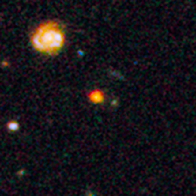 GOODS-N-774, taken by the Hubble Space Telescope. The bright orange object near the center is Sparky.