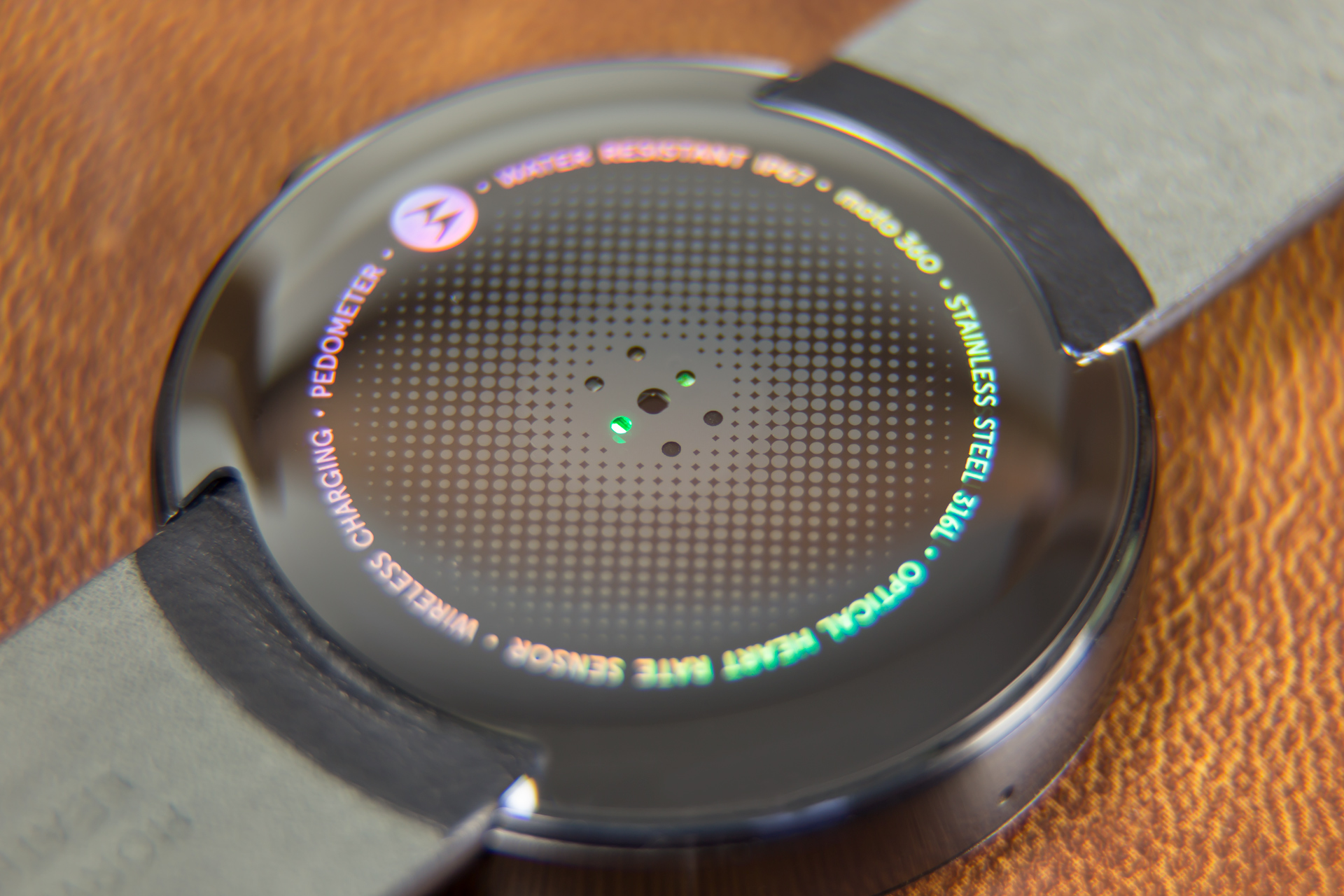 The back side of the watch. The green light and holes are for the optical heart rate sensor.