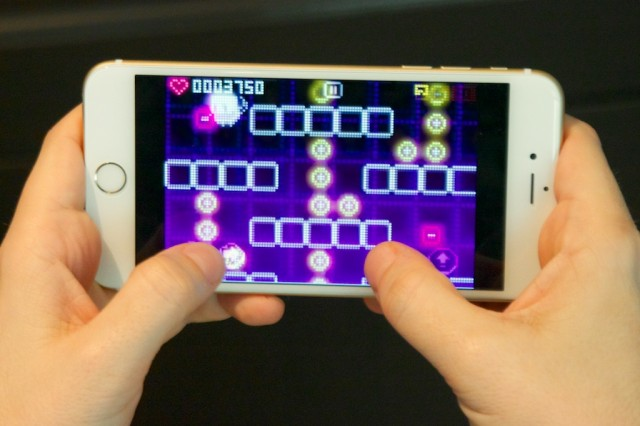 Playing <i>Pix N Love Rush</i> on the iPhone 6 Plus is nice and comfortable...