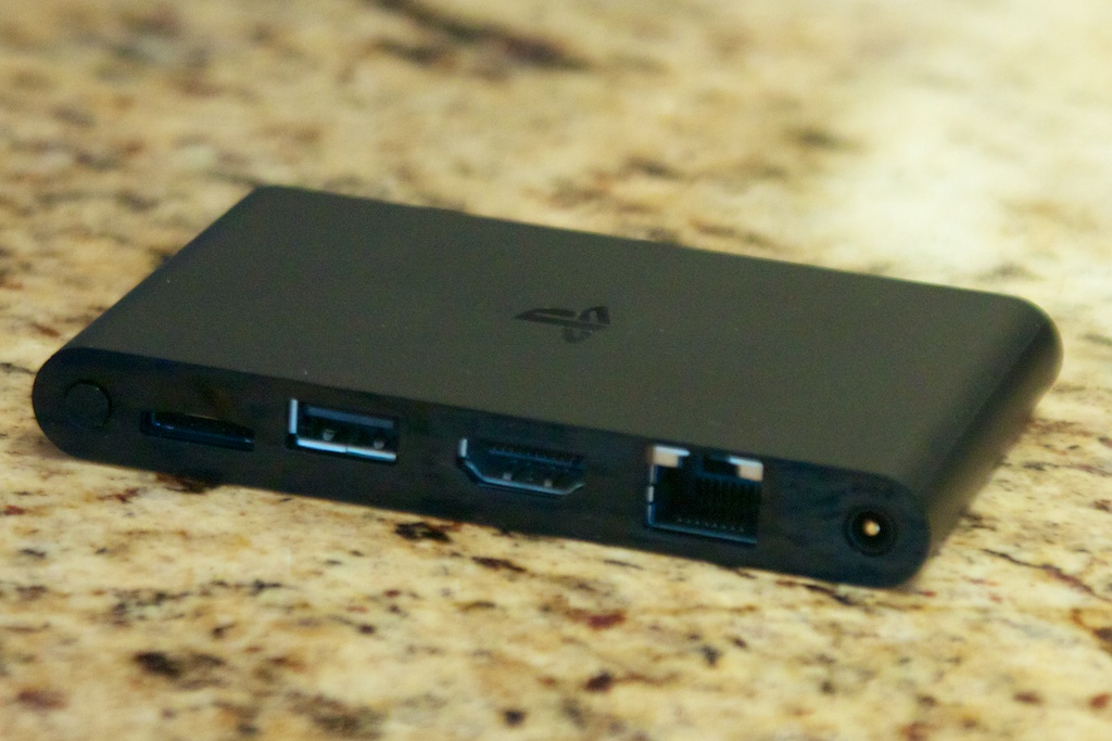 A rear view of the PSTV's ports. Left to right: power button, Vita memory card slot, USB, HDMI, Ethernet, power.