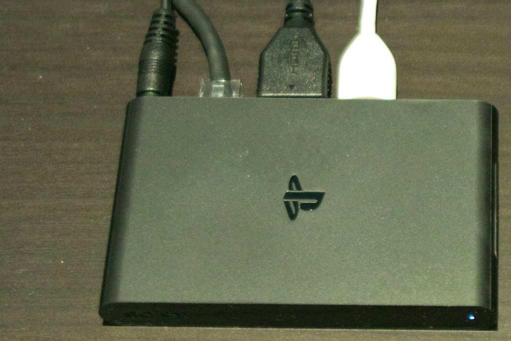 The PSTV is so small that the variety of plugs sticking out the back add appreciably to its bulk.