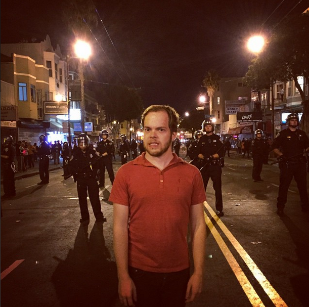 """Benthall on Mission Street in San Francisco, after the Giants won the world series. """"progressive #sf's riot squads are just expensive photo opportunities,"""" he wrote."""