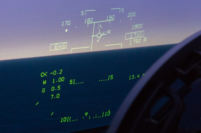 """A military aircraft HUD (in this case, from an <a href=""""http://arstechnica.com/gadgets/2014/12/mach-2-hair-on-fire-ars-flies-the-navys-fa-18-sim-into-the-danger-zone/"""">F/A-18F simulator)</a> showing dense symbology."""