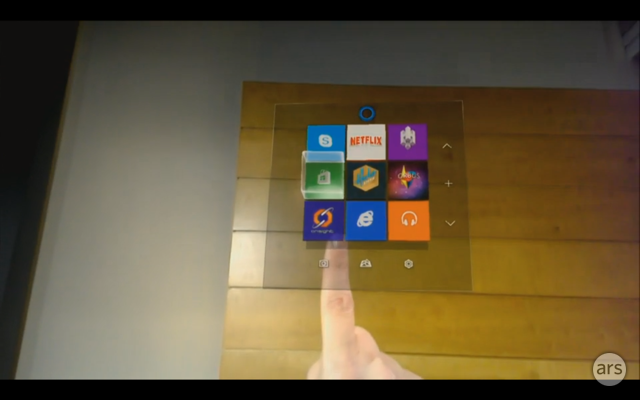An interface element in Windows Holographic projected on a real-world wall, as seen through the HoloLens.