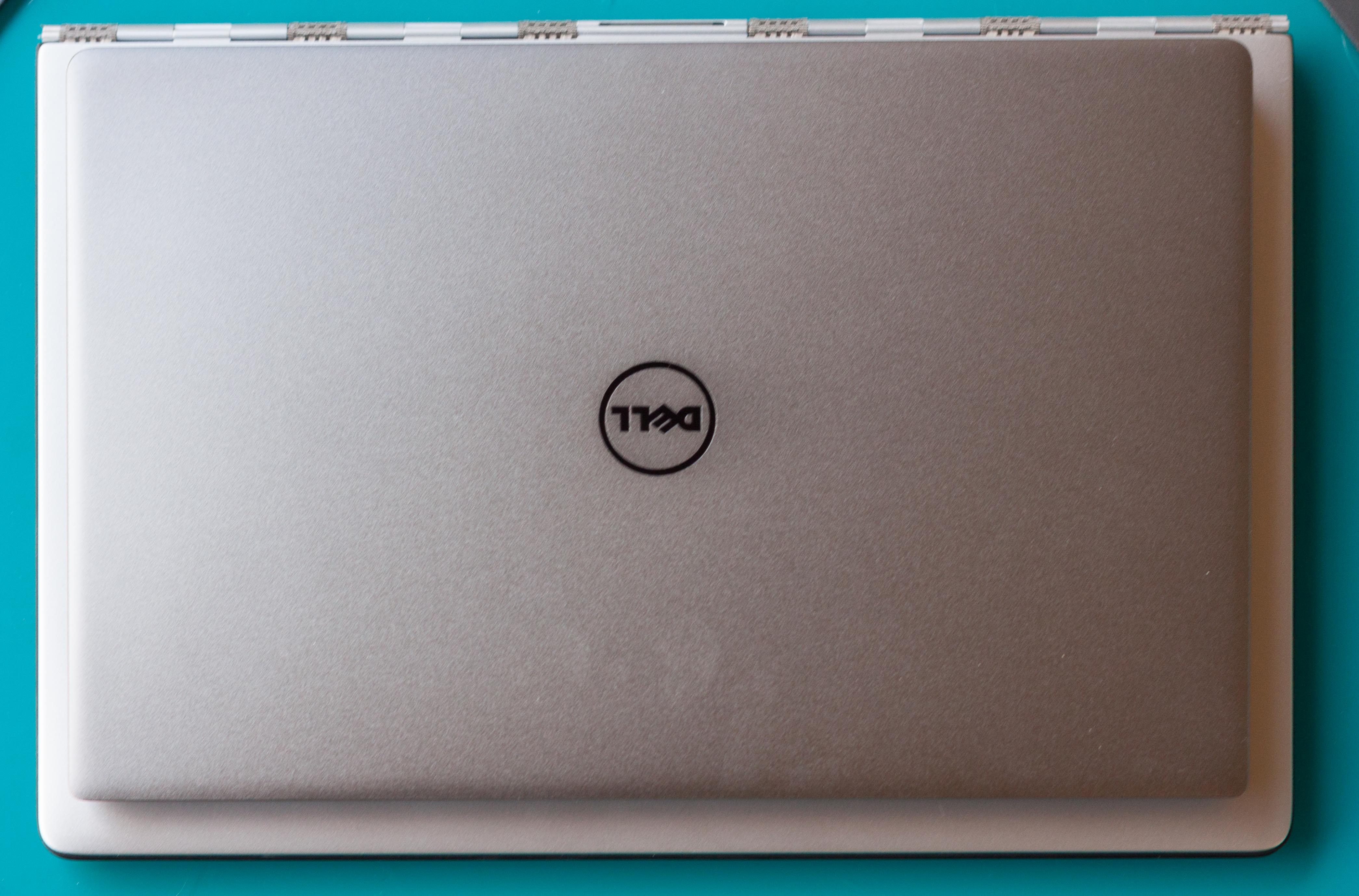 The XPS 13 resting atop the Yoga 3 Pro.