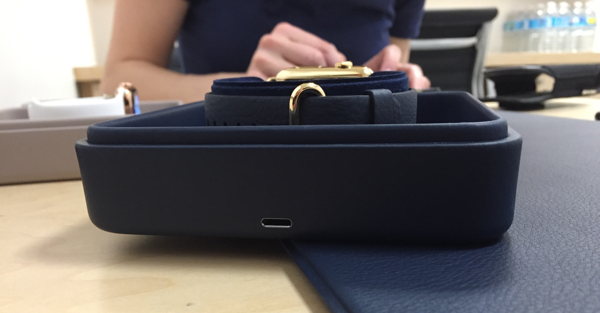 You use a Lightning port on the back of the case to plug the watch in.