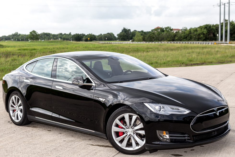 Our demo P85D, on loan from Tesla, with electricity stuff artfully framed in the background.