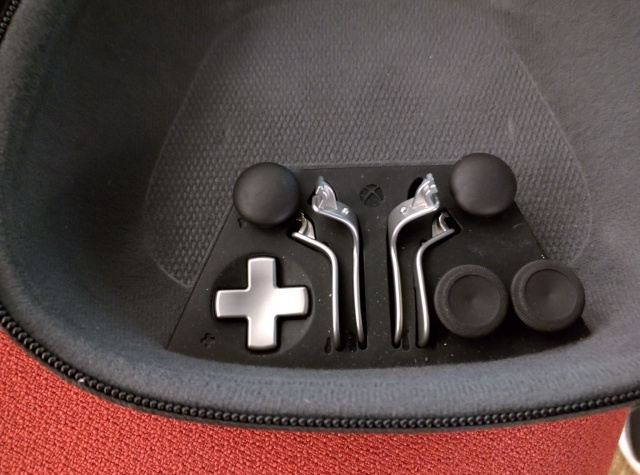 The swappable joystick nubs, d-pad, and paddle buttons, tucked into the new Xbox One Elite controller's handsome carrying case.