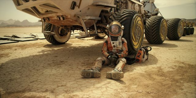 Watney takes a break from the cramped confines of one of the two Ares 3 rovers.