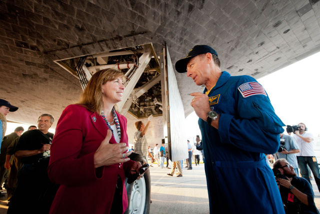 Garver and Commander Chris Ferguson talk underneath the space shuttle Atlantis shortly after the final shuttle mission landed in 2011.