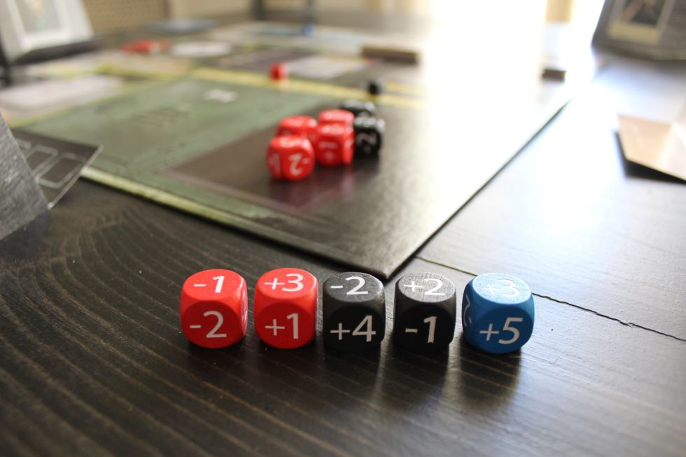 """All dice have the same mix of positive and negative amounts; black dice just happen to have better positive values, while each session's""""commander"""" gets a bonus blue die."""