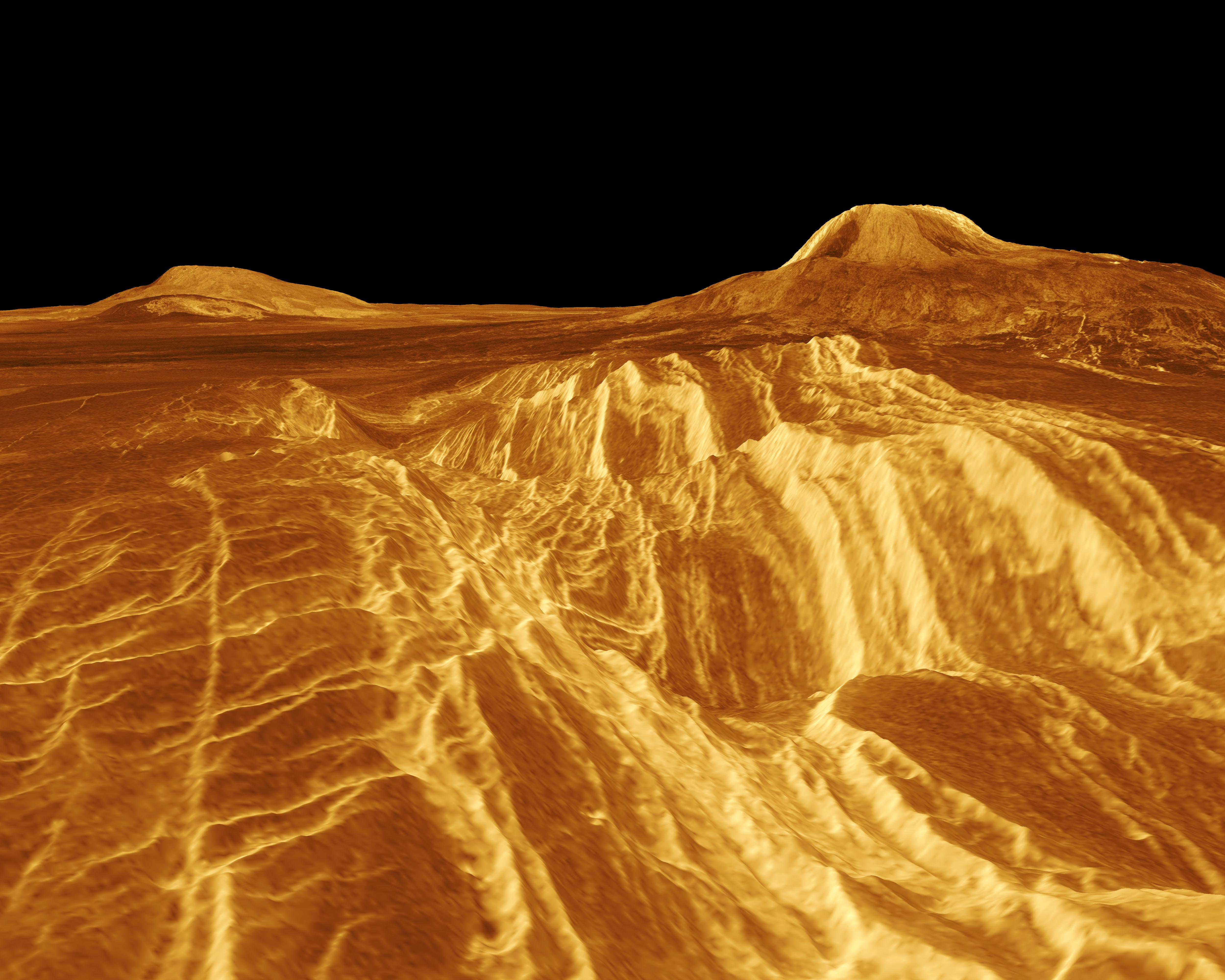 A computer-generated view of Venus' western Eistla Regio. The volcano on the right, Gula Mons, rises 3 km high.