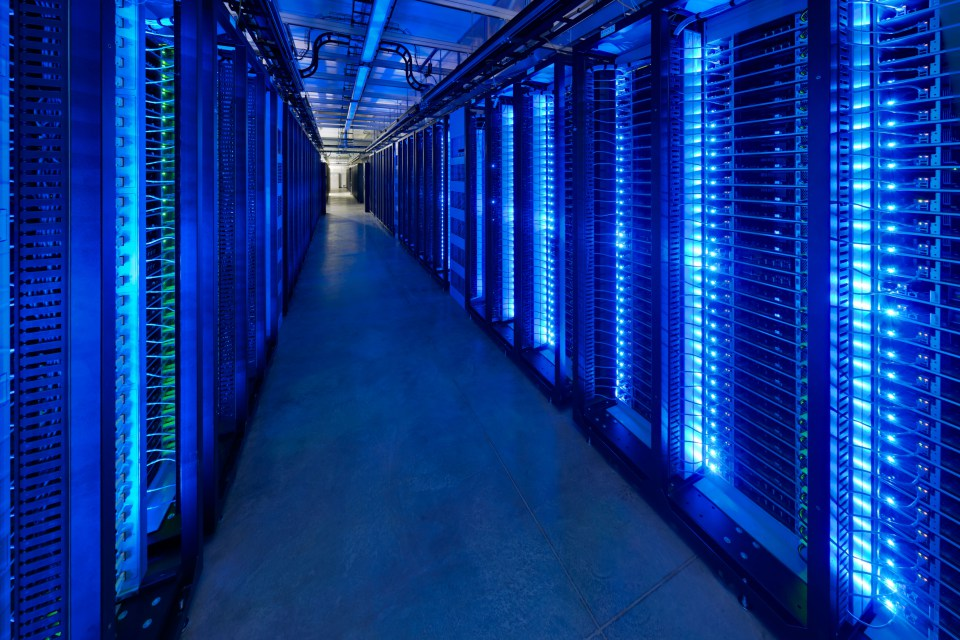 Rows of Open Compute Project racks in a Facebook data center.
