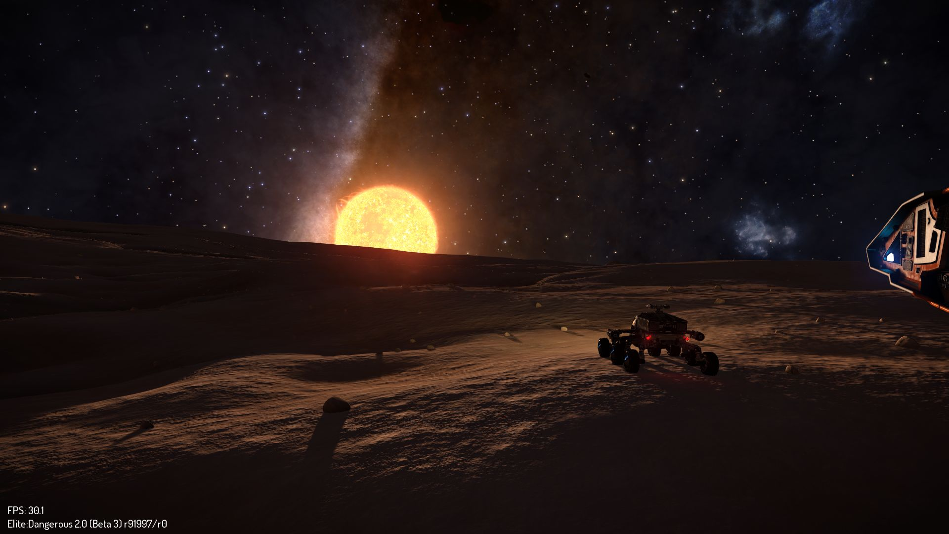 """Sunrise while searching for some cores,"" by CMDR [AEDC] Haridas Gopal. This screenshot shows a player-driven SRV in the foreground on an airless planet."