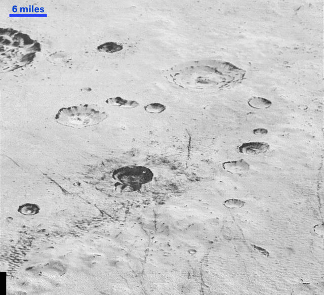Pluto's icy plains and layered craters may be the key to unlocking its curious history.