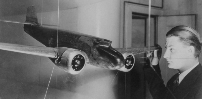 """Clarence L """"Kelly"""" Johnson, seen here with a wind tunnel model of the Lockheed Electra, the first of Lockheed's designs that he influenced."""