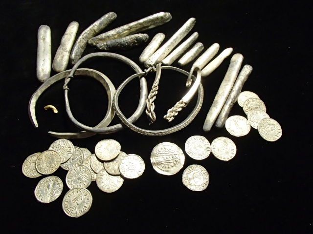 Part of the Viking hoard found in Watlington, including coins, ingots, and arm bands.