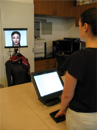 A participant interacts with a robot bearing Face 1.