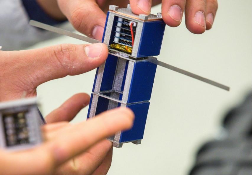 A single, a three-tiered version of a FemtoSat.