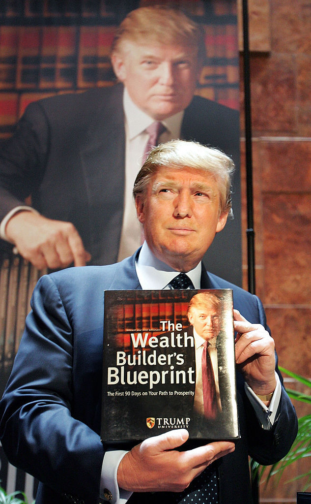 Trump watching Trump at the launch of Trump University.