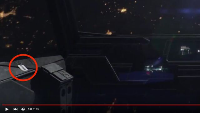 Zoomed-in snippet from the video showing the dog tag.