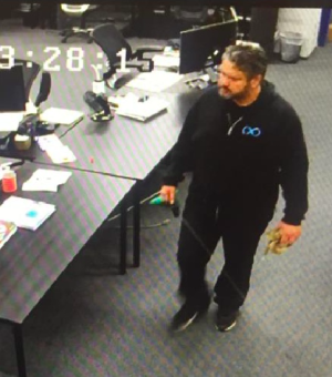 A still from security camera footage in which BamBrogan claims Afshin Pishevar is walking to BamBrogan's desk with rope to leave a noose on his chair.
