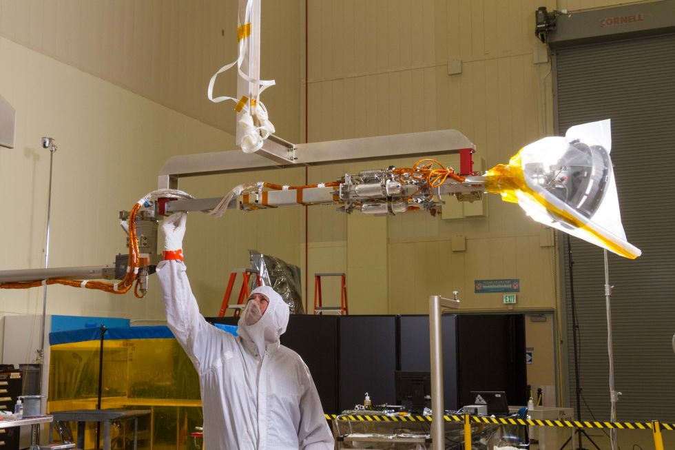 The Touch-and-Go Sample Arm Mechanism is tested in the Lockheed Martin facility.