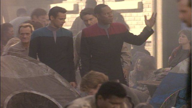 Sisko explains to Bashir that humans of the 21st century rebelled against the government that kept impoverished people in ghettos.