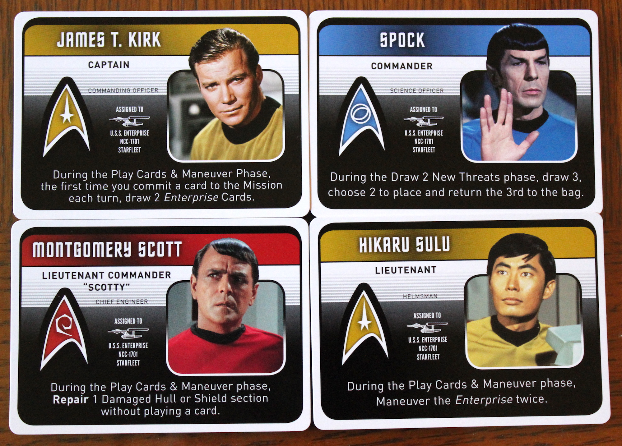"""Four of the """"character cards"""" listing their powers."""