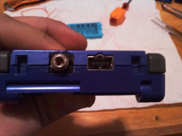 A GBA SP modded to replace the link cable port with a headphone jack.