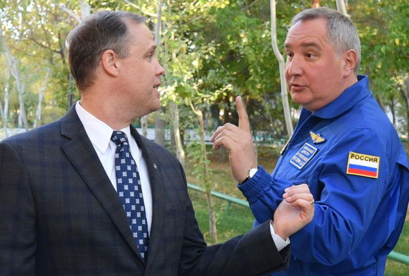 NASA Administrator Jim Bridenstine, left, speaks with Roscosmos' Dmitry Rogozin in 2019.